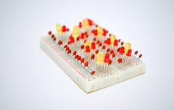 LEDs en elektrocomponenten op de raad Stock Afbeelding