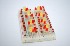 LEDs i elektryczni składniki na desce Zdjęcia Stock