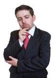 Ledsen affärsman i en svart dräkt Royaltyfri Foto