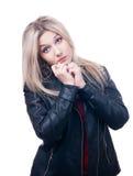 Ledsen blondin i läderomslag royaltyfria foton