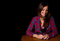 Ledsen flicka som dricker vin Fotografering för Bildbyråer