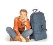 Ledsen kvinna med resväskan Royaltyfri Fotografi