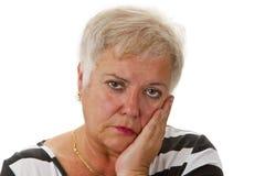 Ledsen kvinnlig pensionär Royaltyfri Foto