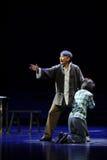 Ledsen ledsen fader- och dotterJiangxi opera en besman Arkivbilder