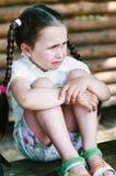 Ledsen och deprimerad liten flicka Arkivbild