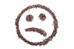 Ledsen smiley från kaffebönor som isoleras på vit bakgrund Royaltyfri Fotografi