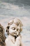 Ledsen sova ängel Idé för en sörjande bakgrund Royaltyfri Bild