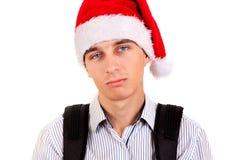 Ledsen ung man i Santa Hat royaltyfria bilder