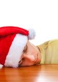 Ledsen ung man i Santa Hat arkivbild