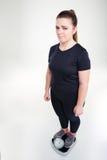 Ledset fett kvinnaanseende på vägningsmaskinen Royaltyfria Foton