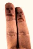 Ledsna fingrar på vit bakgrund Royaltyfria Foton