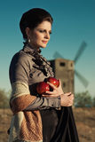 Ledy with apples against the mill Royalty Free Stock Images