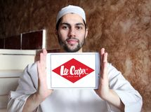Lee Cooper clothing company logo. Logo of Lee Cooper brand on samsung tablet holded by arab muslim man. Lee Cooper Brand is an English clothing company royalty free stock photos