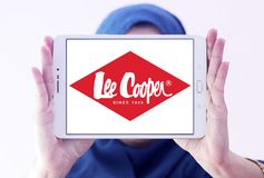 Lee Cooper clothing company logo. Logo of Lee Cooper brand on samsung tablet holded by arab muslim woman. Lee Cooper Brand is an English clothing company royalty free stock photography