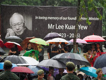 Lee Kuan Yew's funeral procession. Singaporeans waiting for Mr Lee Kuan Yew's hearse to pass by to bid their final farewell during a heavy downpour on 29 March Stock Photo