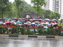 Lee Kuan Yews funeral procession. Singaporeans waiting for Mr Lee Kuan Yews hearse to drive pass, to bid their final farewell during a heavy downpour on 29 March Stock Photos