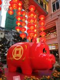 Lee Tung Street Chinese New Year decoration. Big red pig money save box king size with latterns royalty free stock image