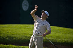 Lee Westwood. Tossing the ball into the crowd, after sinking a birdie on the 18th Royalty Free Stock Images