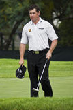 Lee Westwood. On the 18th green. Cap off, putter in hand Royalty Free Stock Photo