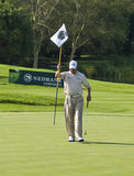 Lee Westwood Removing the 18th Flag. Removing the Flag, preparing for final putt — 18th hole Stock Photo