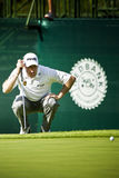 Lee Westwood Taking Aim. Taking aim, for his put on the 18th green Royalty Free Stock Photos