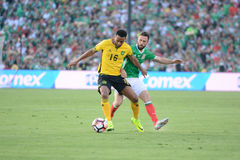 Lee Williamson and  Miguel Layun fighting for the ball Stock Photography
