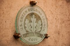 Leed Gold building plaque. This plaque awarded to only the top buildings that meet the LEED Gold standard of construction and  is a symbol of pride and Stock Image