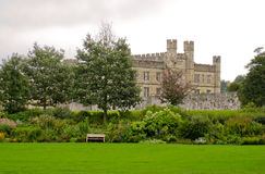 Leeds castle. And a grass field with a bench Royalty Free Stock Photos