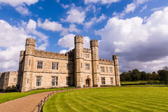 Leeds Castle in England. Leeds Castle in Kent England grounds, walkway, sky and clouds in England Royalty Free Stock Images