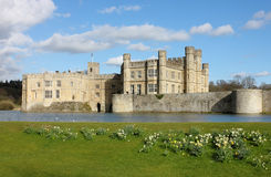 Leeds Castle in Kent, United Kingdom. Frontal view with blooming daffodils royalty free stock photography