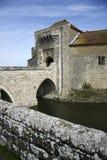 Leeds castle moat bridge kent england. Ancient stone bridge crossing the moat of leeds castle in kent england Royalty Free Stock Images