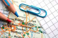 Leeds city of Great Britain in the center of the geographic map. Pencils and paper sheet royalty free stock photography