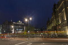 Leeds City Square at night. Leeds City Square with light trails of traffic racing through royalty free stock photography