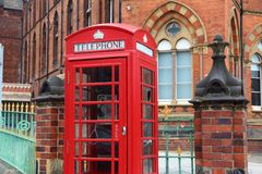 Leeds. City in West Yorkshire, UK. Red telephone and  General Infirmary in background Royalty Free Stock Image