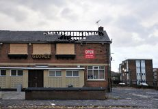 A closed public house stands derelict and boarded on a housing estate in hunslet leeds after being attacked by vandals. Leeds, England - September 24, 2017: A Royalty Free Stock Photos