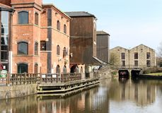 Canal and Buildings. The Leeds Liverpool canal with the old buildings and barges at Wigan Pier Stock Photography