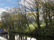 Leeds Liverpool Canal at Salterforth in the beautiful countryside on the Lancashire Yorkshire border in Northern England. Salterforth is a village within the Royalty Free Stock Image