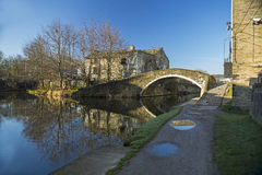 Leeds Liverpool Canal at Shipley. Junction Bridge and the old Toll House on the Leeds Liverpool Canal, In Shipley, West Yorkshire, England, showing the tow path Stock Image
