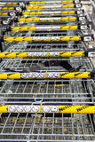 LEEDS, UK - 20 AUGUST 2015. Netto supermarket shopping trollies. LOts of supermarket trollies in a row Royalty Free Stock Photography