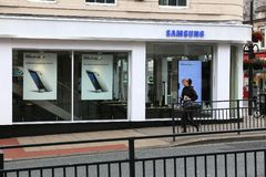 Samsung store UK. LEEDS, UK - JULY 12, 2016: People walk by Samsung electronics shop in Leeds, UK. Samsung is a multinational conglomerate focusing on Stock Photos