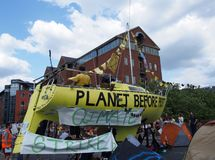 The large yellow boat banners and people in the road at the extinction rebellion protest blocking victoria bridge in leeds royalty free stock photography