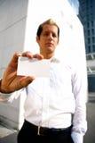 Leeg adreskaartje in een hand Stock Afbeelding