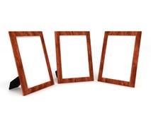 Leeg houten kader voor foto's op wit Stock Fotografie