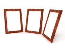 Leeg houten kader voor foto's op wit Stock Foto