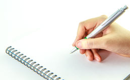 Leeg notitieboekje met hand die een pen houden Royalty-vrije Stock Foto