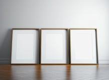 Leeg omlijsting drie en zonlicht op een muur 3d geef terug royalty-vrije illustratie