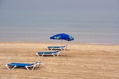 Leeg overzees strand Stock Afbeeldingen