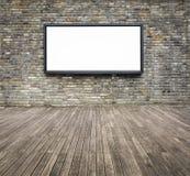 Leeg reclameaanplakbord op een bakstenen muur Royalty-vrije Stock Foto's