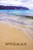 Leeg Word geschreven op zand, op een mooi strand Stock Fotografie