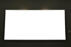Leeg zwart het schilderen kader op zwarte muur Royalty-vrije Stock Afbeeldingen